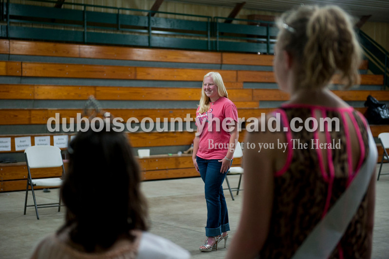 Carolyn Van Houten/The Herald<br /> Haley Thayer of Birdseye, 15, practiced walking in her heels up to the microphone to answer a question during the free Modeling Workshop held at the Dubois County 4-H Fairgrounds on Thursday.  The workshop was hosted by the Dubois County 4-H Council and the Dubois County 4-H Queens Committee to assist 4-H Fair Queen contestants for Miss and Junior Miss prepare for the contest.