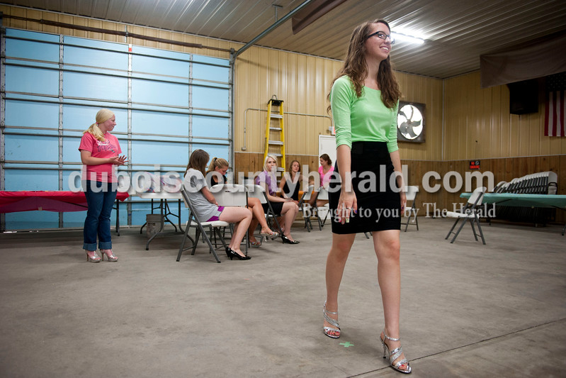 Carolyn Van Houten/The Herald<br /> Jenna Bieker of St. Anthony, 18, practiced walking in her heels for the judges during the free Modeling Workshop held at the Dubois County 4-H Fairgrounds on Thursday.  The workshop was hosted by the Dubois County 4-H Council and the Dubois County 4-H Queens Committee to assist 4-H Fair Queen contestants for Miss and Junior Miss prepare for the contest.