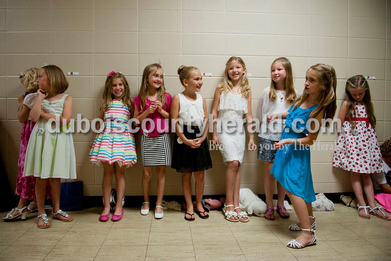Carolyn Van Houten/The Herald<br /> The Little Miss Heimatfest contestants waited in the hall during the Miss Heimatfest Pageant in the Forest Park Auditorium in Ferdinand on Sunday.  The Little Miss and Little Mister Heimatfest Pageants were held simultaneously.  There were eight Miss Heimatfest contestants who walked on stage in work wear, theme wear and formal wear rounds.  During the last round, each contestant was asked impromptu questions.  The 2014 Miss Heimatfest winner was Shelby Klem of Ferdinand, 18, who was also Miss Photogenic.  The First Runner-up was Sabrina Becher, 16, of Ferdinand.  Tiffany Singer of Ferdinand, 18, won Miss Congeniality.