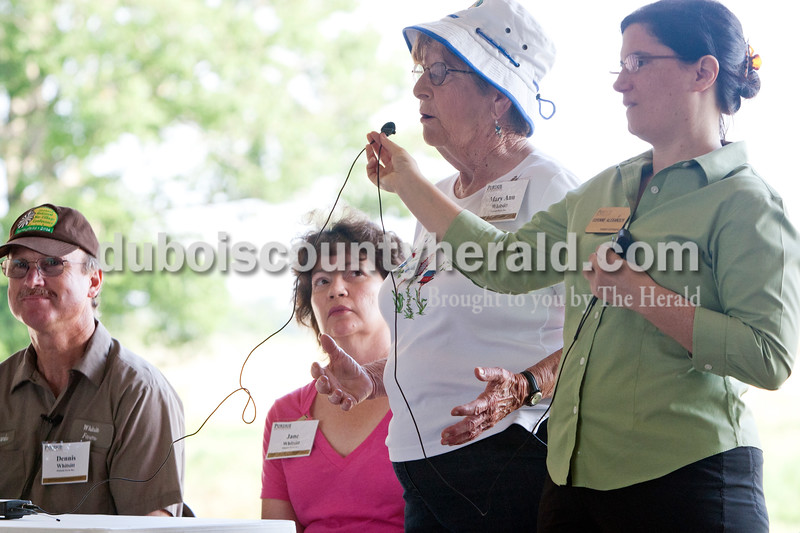 Heather Rousseau/The Herald<br /> The Whitsitt's spoke about their farm beginning with Mary Ann Whitsitt, second from right, as her son, Dennis, left, and his wife, Jane listened and Corinne Alexander with Purdue Extension, right, held the microphone for a crowd of about 100 people to hear. The Whitsitt Farm Inc. was one of five farms visited during the 82nd Annual Indiana Farm Management Tour that took place on Monday and Tuesday.  The Whitsitt Farm tour focused on technology, producing value-added crops such as popcorn and conservation oriented farming practices.