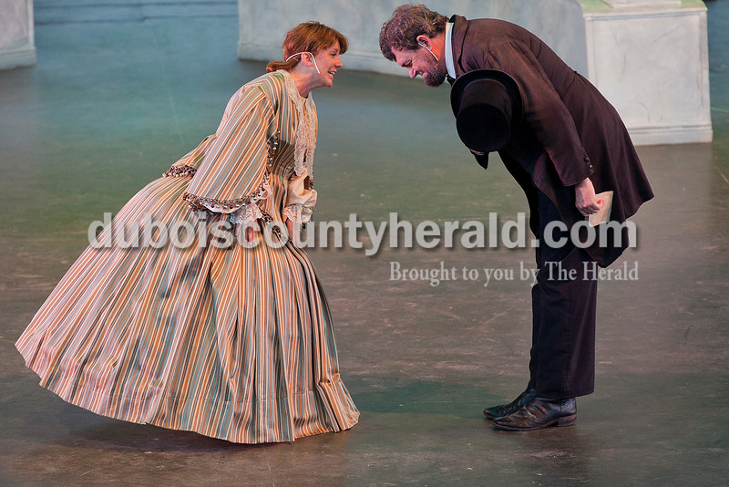 Julie Wadsworth, left, and Dean Dorrell, both of Washington, played the roles of Mary Todd Lincoln and President Lincoln, respectively, during a dress rehearsal for A. Lincoln: A Pioneer Tale Tuesday at the Lincoln Amphitheatre inside Lincoln State Park. The play will run June 19-July 26. Rachel Mummey/The Herald