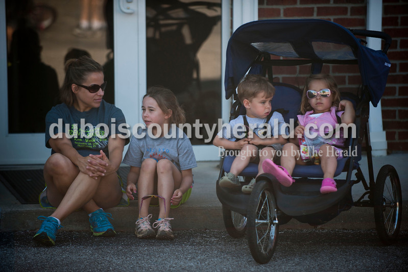 """Carolyn Van Houten/The Herald<br /> Melissa Hargett of Huntingburg sat with her children Ayla Hargett, 7, Rylan Hargett, 2, and Aubrey Hargett, 2, before participating in the """"5-5-5"""" monthly 5k walk/run on Friday hosted by the City of Huntingburg."""