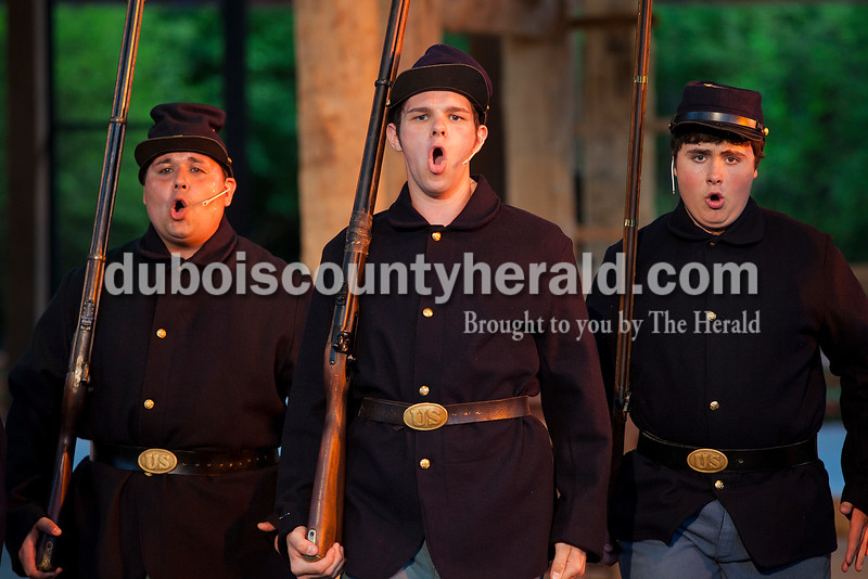Shane Denu of Jasper, left, Trey Paris of Eminence, and Kyle Burgess of Boonville, 15, played the Civil War soldiers during a dress rehearsal for A. Lincoln: A Pioneer Tale Tuesday at the Lincoln Amphitheatre inside Lincoln State Park. The play will run June 19-July 26. Rachel Mummey/The Herald
