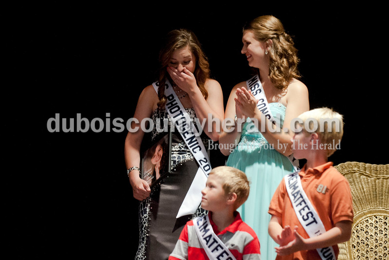 Carolyn Van Houten/The Herald<br /> Shelby Klem of Ferdinand, 18, reacted to being named the 2014 Miss Heimatfest winner and Miss Photogenic during the Miss Heimatfest Pageant in the Forest Park Auditorium in Ferdinand on Sunday.  The Little Miss and Little Mister Heimatfest Pageants were held simultaneously.  There were eight Miss Heimatfest contestants who walked on stage in work wear, theme wear and formal wear rounds.  During the last round, each contestant was asked impromptu questions.  The First Runner-up was Sabrina Becher, 16, of Ferdinand.  Tiffany Singer of Ferdinand, 18, top right, won Miss Congeniality.  Leo Widolff, lower left, was named the 2014 Little Mister Heimatfest and Bryson Frick, lower right, was named First Runner-up.  Both are 7 and of Ferdinand.