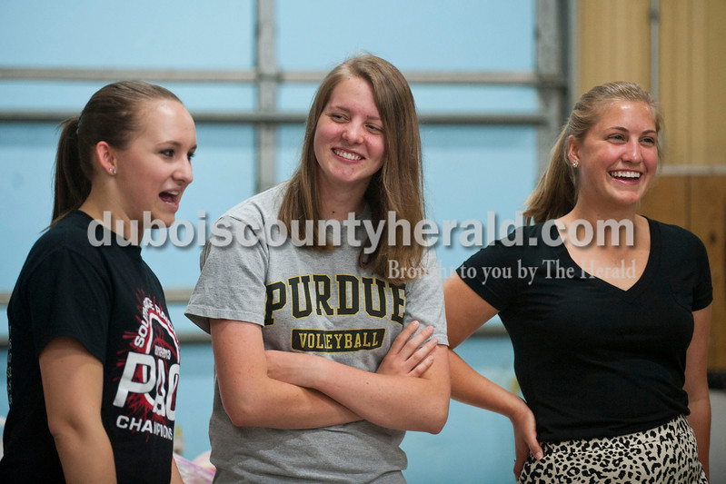 Carolyn Van Houten/The Herald<br /> Jayme Lindauer of St. Henry, 19, left, Elise Fischer of Jasper, 18, and Shelby Hopf of Jasper, 19, laughed and talked together during the free Modeling Workshop held at the Dubois County 4-H Fairgrounds on Thursday.  The workshop was hosted by the Dubois County 4-H Council and the Dubois County 4-H Queens Committee to assist 4-H Fair Queen contestants for Miss and Junior Miss prepare for the contest.