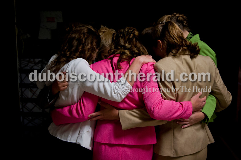 Carolyn Van Houten/The Herald<br /> The Miss Heimatfest contestants huddled together for one last pep talk before the Miss Heimatfest Pageant in the Forest Park Auditorium in Ferdinand on Sunday.  The Little Miss and Little Mister Heimatfest Pageants were held simultaneously.  There were eight Miss Heimatfest contestants who walked on stage in work wear, theme wear and formal wear rounds.  During the last round, each contestant was asked impromptu questions.  The 2014 Miss Heimatfest winner was Shelby Klem of Ferdinand, 18, who was also Miss Photogenic.  The First Runner-up was Sabrina Becher, 16, of Ferdinand.  Tiffany Singer of Ferdinand, 18, won Miss Congeniality.