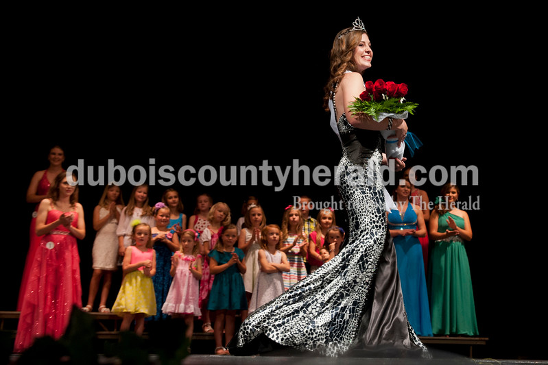Carolyn Van Houten/The Herald<br /> Shelby Klem of Ferdinand, 18, walked across the stage after being named the 2014 Miss Heimatfest winner and Miss Photogenic during the Miss Heimatfest Pageant in the Forest Park Auditorium in Ferdinand on Sunday.  The Little Miss and Little Mister Heimatfest Pageants were held simultaneously.  There were eight Miss Heimatfest contestants who walked on stage in work wear, theme wear and formal wear rounds.  During the last round, each contestant was asked impromptu questions.  The First Runner-up was Sabrina Becher, 16, of Ferdinand.  Tiffany Singer of Ferdinand, 18, won Miss Congeniality.