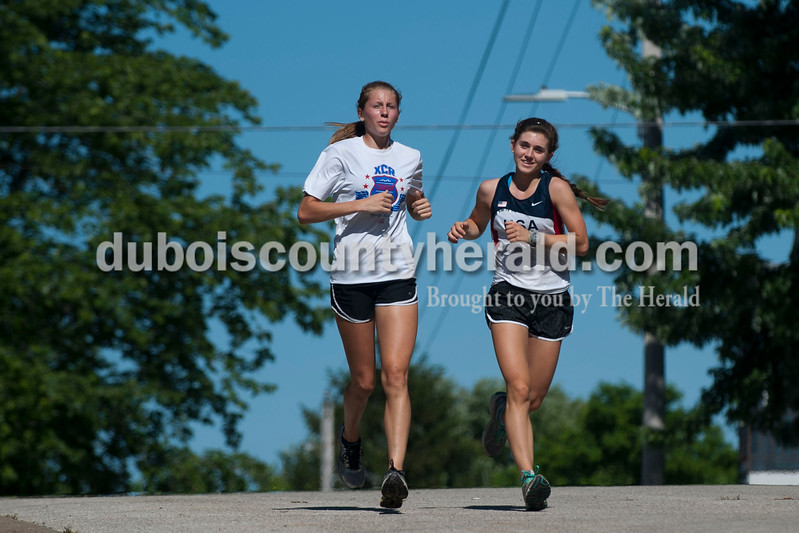 """Carolyn Van Houten/The Herald<br /> Southridge track team members Aubrey Main, 17, left, and Lauren Meyer, 15, both of Huntingburg, ran in the """"5-5-5"""" monthly 5k walk/run on Friday hosted by the City of Huntingburg."""