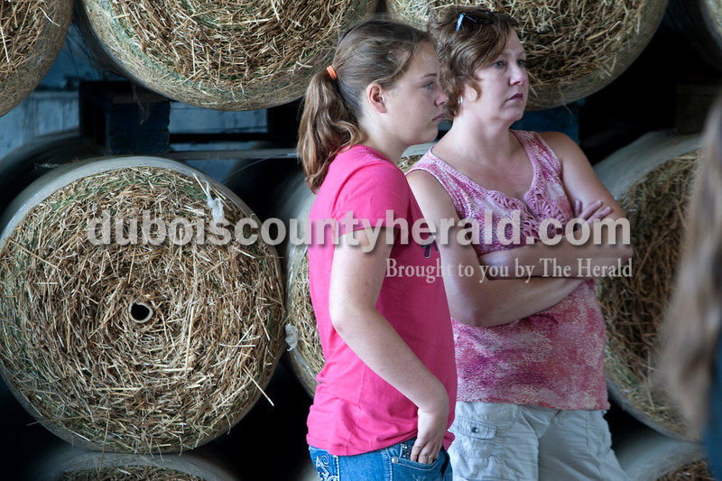 """Heather Rousseau/The Herald<br /> Kristin, 12, and her mom, Kelly Berberich, both of Mt. Carmel Ill. listened as the Whitsitt family spoke about their farming practices at their farm in Duff on Tuesday morning during the 82nd Annual Indiana Farm Management Tour. The tours this year took place at five farms throughout  Spencer and Dubois Counties. """"We have a grain farm and wanted to see how others do things,"""" said Kelly."""