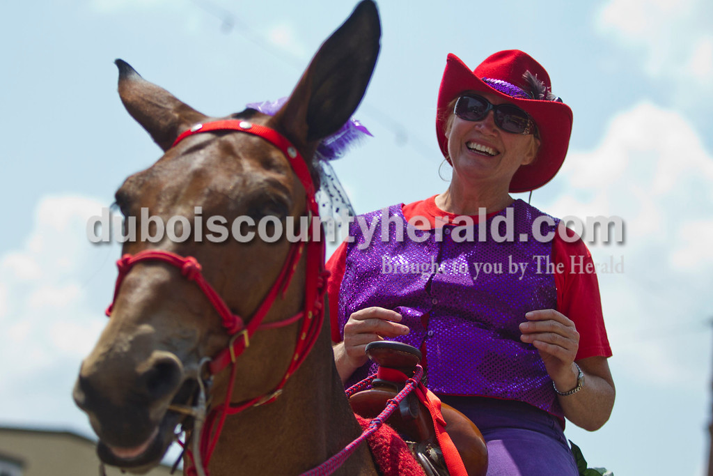 Joan Wealing of Remington rode her mule, Rosco, in the Jasper Strassenfest Parade on Sunday. <br /> Caitlin O'Hara/The Herald