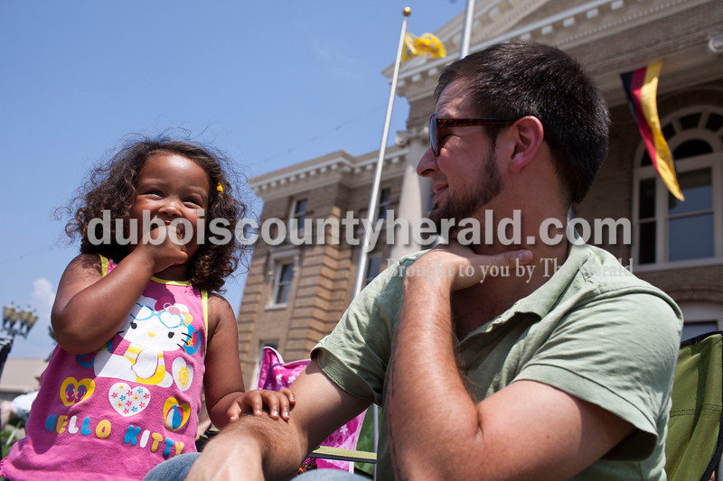 Nathan Bright of Jasper smiled at his daughter, Sophia, 4, during the Jasper Strassenfest Parade on Sunday.<br /> Caitlin O'Hara/The Herald