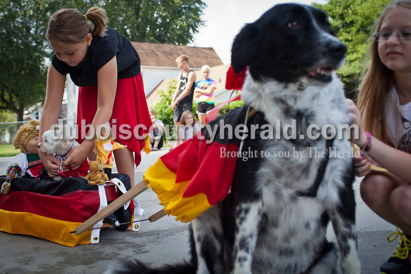 Sydney Schmitt, 9, of Jasper, got her pup, Zoe, ready before the pet contest at Robert E. Parker Park on Saturday. At right, Eliana Kaufmann, 9, of Jasper pets Shadow. The contest was part of the Jasper Strassenfest celebration.<br /> Caitlin O'Hara/The Herald