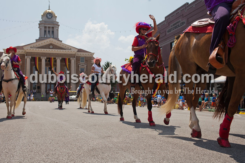Horses, mules and their riders marched in the Jasper Strassenfest Parade on Sunday.<br />  Caitlin O'Hara/The Herald