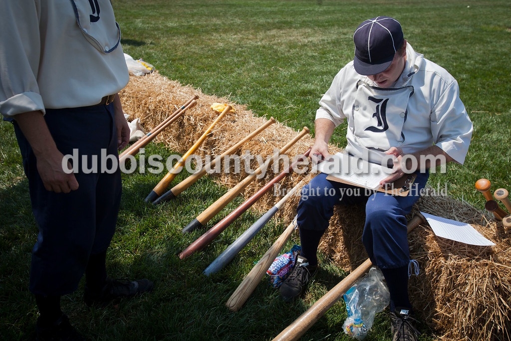 """Indianapolis Blues team manager Jonathan Dorris of Indianapolis kept score during the vintage baseball game against the Dayton Clodbusters at the Schroeder Complex on Saturday. The teams played two games with Civil War-era """"base ball"""" rules as a part of the Jasper Strassenfest celebration. <br /> Caitlin O'Hara/The Herald"""