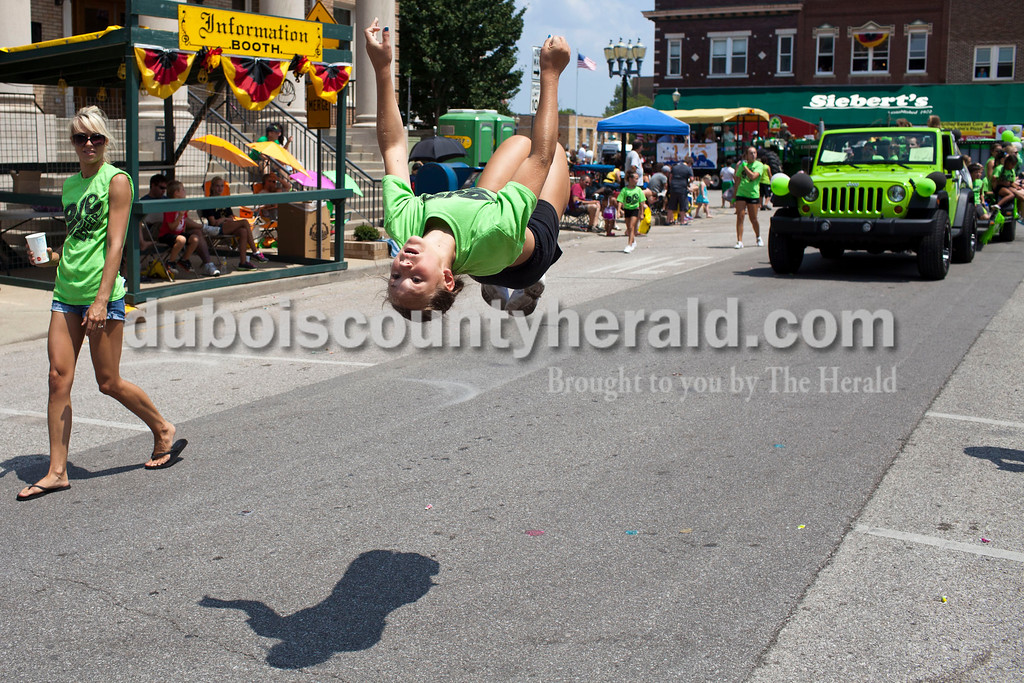 Corbyn Zehr, 12, of Dubois flipped during the Jasper Strassenfest Parade on Sunday.<br /> Caitlin O'Hara/The Herald
