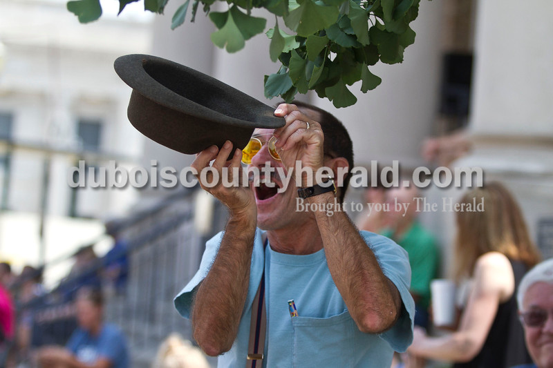 Richard Mangel of Holland caught candy in his hat at the Jasper Strassenfest Parade on Sunday.<br /> Caitlin O'Hara/The Herald
