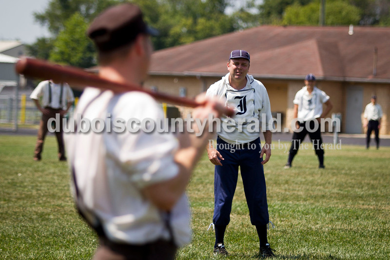 "Indianapolis Blues team manager Jonathan Dorris of Indianapolis prepared to pitch during the vintage baseball game against the Dayton Clodbusters at the Schroeder Complex on Saturday. The teams played two games with Civil War-era ""base ball"" rules as a part of the Jasper Strassenfest celebration. <br /> Caitlin O'Hara/The Herald"
