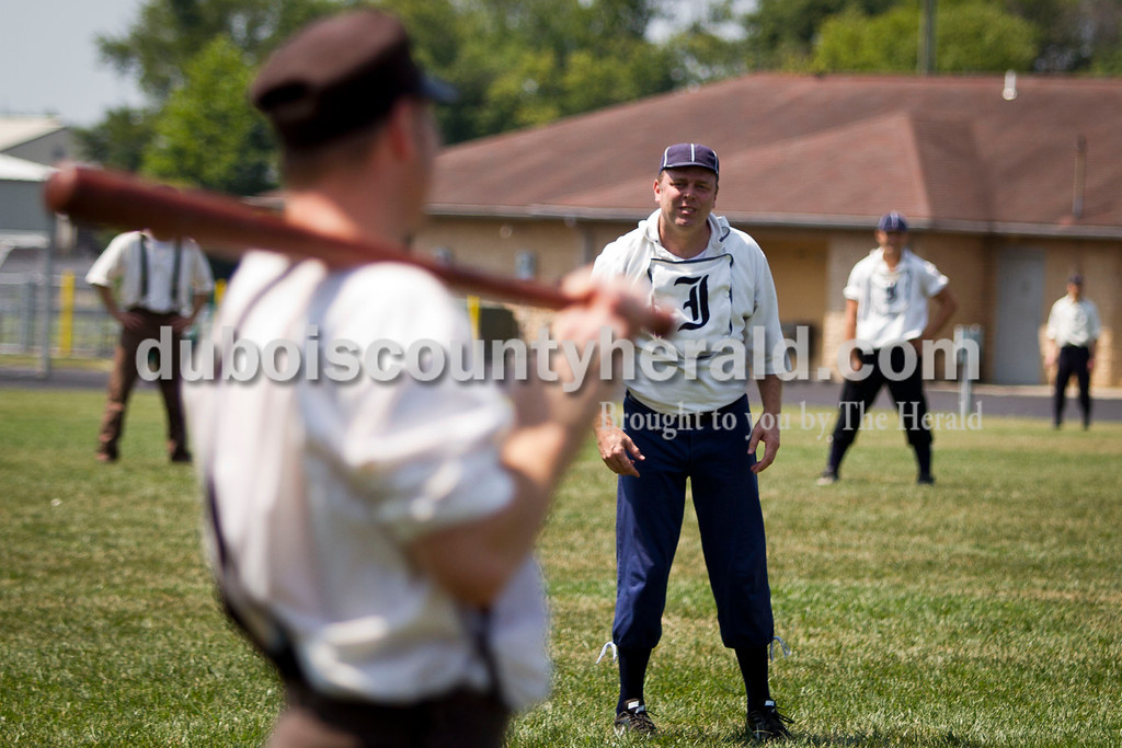 """Indianapolis Blues team manager Jonathan Dorris of Indianapolis prepared to pitch during the vintage baseball game against the Dayton Clodbusters at the Schroeder Complex on Saturday. The teams played two games with Civil War-era """"base ball"""" rules as a part of the Jasper Strassenfest celebration. <br /> Caitlin O'Hara/The Herald"""