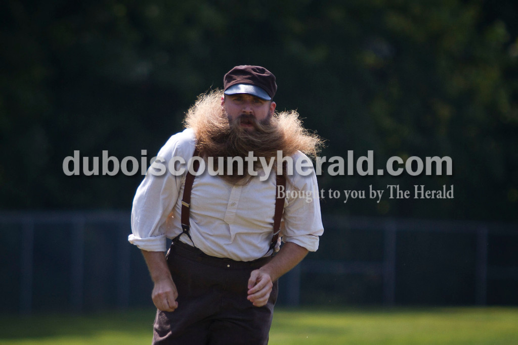 """Neil Muherman of Dayton, Ohio ran home during the Dayton Clodbusters vintage baseball game against the Indianapolis Blues at the Schroeder Complex on Saturday. The teams played two games with Civil War-era """"base ball"""" rules as a part of the Jasper Strassenfest celebration. <br /> Caitlin O'Hara/The Herald"""