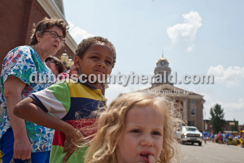 Steven Sturgeon, 6, watched the Jasper Strassenfest Parade with his sister, Trinity Mayfield, 3, both of Cordon, on Sunday. Caitlin O'Hara/The Herald