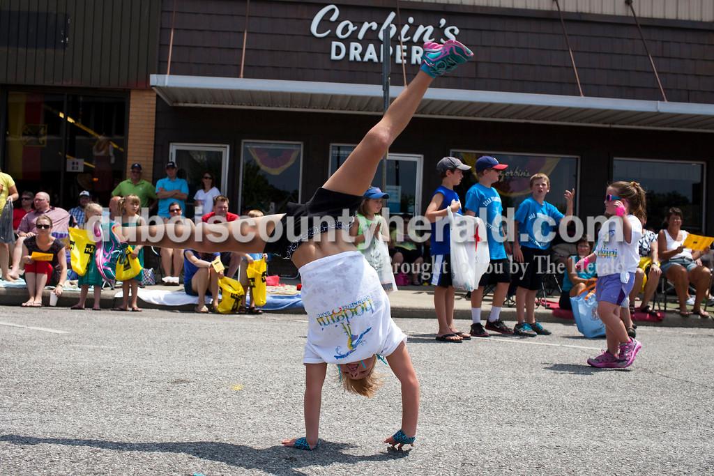 Elizabeth Louviere, 8, of Jasper, cartwheeled through the Jasper Strassenfest Parade on Sunday.<br /> Caitlin O'Hara/The Herald