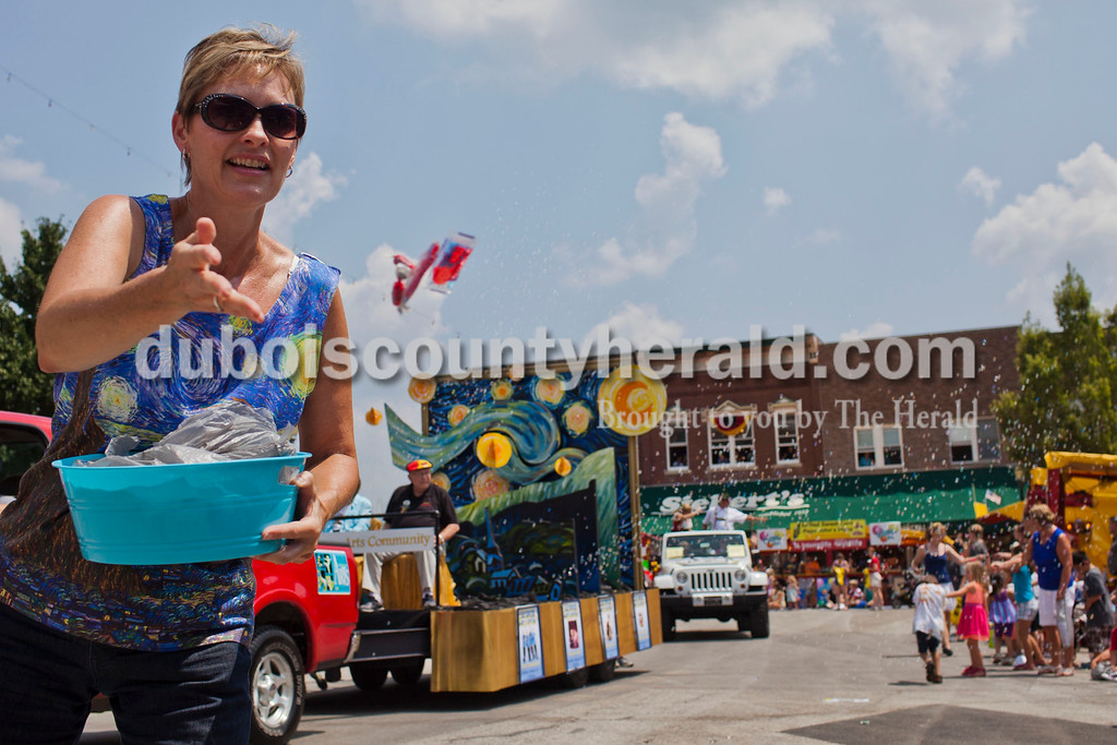 """Karen Grewe of Jasper threw candy as a representative for the Jasper Community Arts Commission at the Jasper Strassenfest Parade on Sunday. Their float was a take on Vincent Van Gogh's """"Starry Night"""" painting to reflect this year's Strassenfest theme, """"Alive with the Arts."""" Caitlin O'Hara/The Herald"""