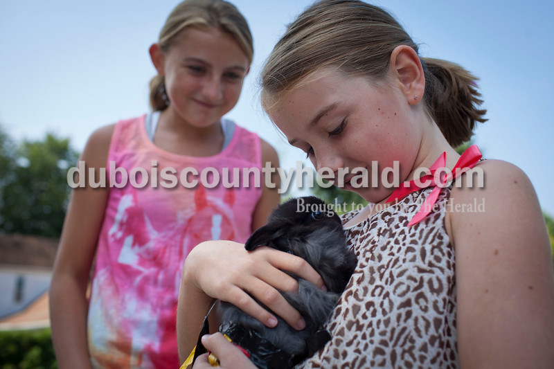Sadie Waddell, 8, right, held Pixie a French angora rabbit, while her sister, Sydney, 12, looks on at the pet contest at Robert E. Parker Park on Saturday. The contest was part of the Jasper Strassenfest celebration.<br /> Caitlin O'Hara/The Herald