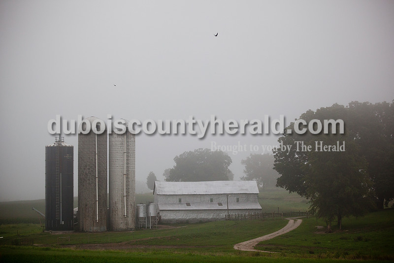 Rachel Mummey/The Herald<br /> Mid-morning fog cloaked a farm along 600W in Jasper on Monday. Isolated thunderstorms continued from the weekend but dried up in the afternoon.