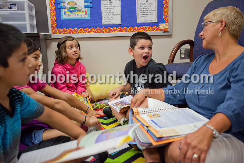Rachel Mummey/The Herald<br /> Second-grader Noah Humbert, second from right, hesitantly answered a question from his teacher Karen Snyder, right, as she led a small group review of reading skills with students Brian Cruz, left, Nicole Fant, and Allison Turner on Monday at Huntingburg Elementary School. Snyder held small group assessment intervention time to assist children prepare for the DIBELS, Dynamic Indicators of Basic Early Literacy Skills.