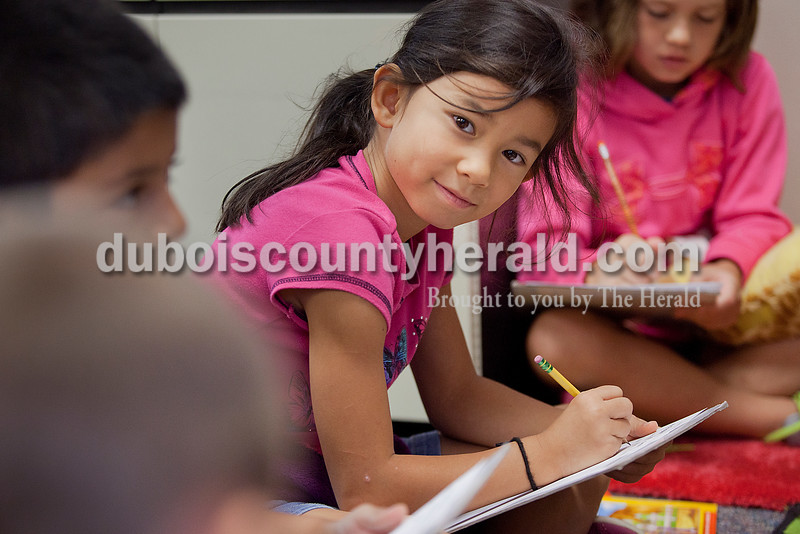 Rachel Mummey/The Herald<br /> Second-grader Nicole Fant listened to her classmates answer questions from their teacher Karen Snyder as she led a small group review of reading skills on Monday at Huntingburg Elementary School. Snyder held small group assessment intervention time to assist children prepare for the DIBELS, Dynamic Indicators of Basic Early Literacy Skills.