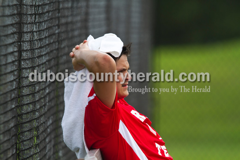 Southridge senior Corbin New rested between sets during the No. 1 singles match against Northeast Dubois in Dubois on Tuesday. Northeast Dubois won 5-0.<br /> Caitlin O'Hara/The Herald