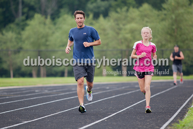 Rachel Mummey/The Herald<br /> The Dubois County Herald sport reporter Joe Jasinski of Jasper, left, ran with Cheyanne Motteler,12, of Holland, during the Don't Sweat It Fitness Krispy Kreme Challenge at Jasper Middle School on Saturday morning. Jasinski and Motteler came in first place. All the proceeds went to the Autism Speaks organization.