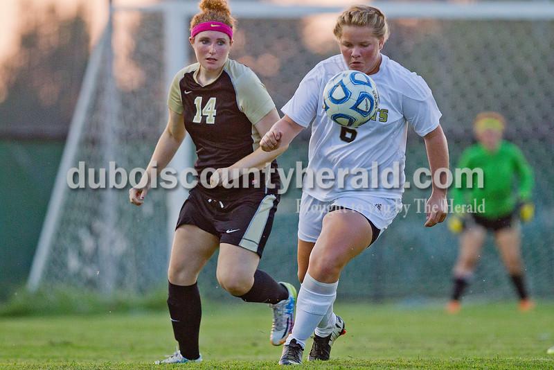 Jasper's Samantha Kabrick, right, battled for the ball against Boonville's Alyssa Morgan during Monday's game in Jasper. Rachel Mummey/The Herald