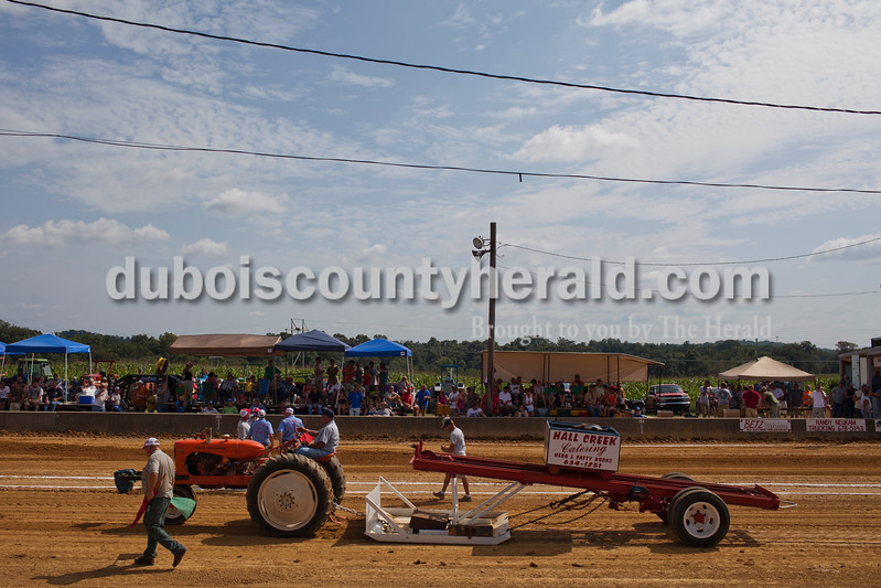 Caitlin O'Hara/The Herald<br /> Johnny Weidenbenner of Jasper competed in the 32nd annual Celestine Tractor Pull at the Celestine Community Club on Sunday. Weidenbenner has competed in the event every year since its debut. The event benefitted the Celestine Volunteer Fire Department.