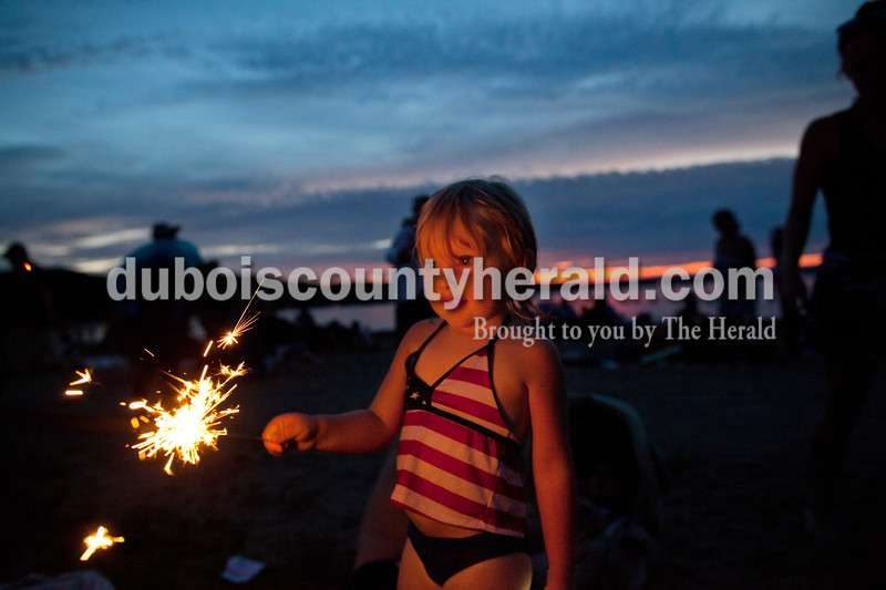 """Shaylinn Asbery of French Lick, 3, played with a sparkler before the """"Thunder over Patoka"""" fireworks display at Patoka Lake on Saturday, July 5. <br /> <br /> (mom is Morgan, 812- 653-4653 call to let her know when this will run)"""