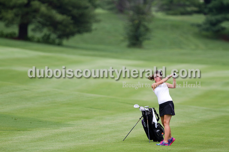 Caitlin O'Hara/The Herald<br /> Southridge's Megan Weitkamp watched her ball at the Wildcat Invitational at Buffalo Trace Golf Course in Jasper on Saturday.
