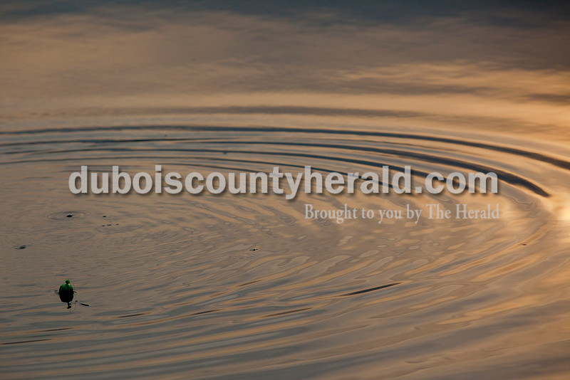 Rachel Mummey/The Herald<br /> A fishing bobber floated in evening waters at Holland Lake.
