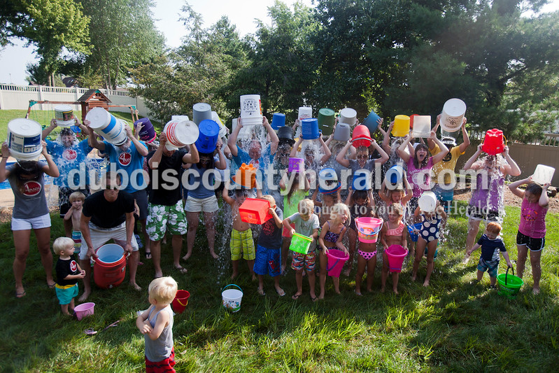 """Caitlin O'Hara/The Herald<br /> Family and friends completed the Ice Bucket Challenge at Kristen (Seitz) Ruhe's home in Jasper on Saturday. Kristen is the daughter of Ann Seitz who passed away from Amyotrophic Lateral Sclerosis in 2010. The Ice Bucket Challenge is a viral fundraising campaign benefitting The ALS Association, and you can donate at  <a href=""""http://www.alsa.org"""">http://www.alsa.org</a>."""