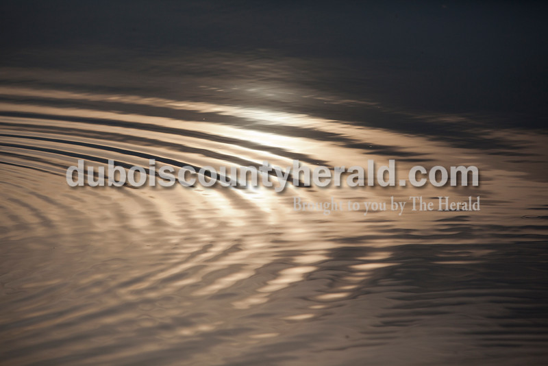 Rachel Mummey/The Herald<br /> Evening waters rippled from a fishing lure at Holland Lake.