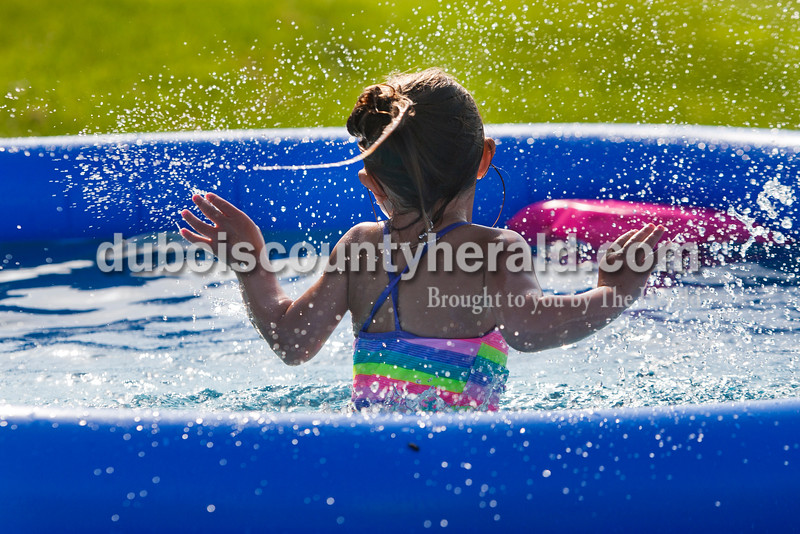 """Ava Gehlhausen of Huntingburg, 3, splashed in her new pool at her home June 17. Herald photo by Heather Rousseau.   <b>From Photoshop:</b> Heather Rousseau/The Herald Ava Gehlhausen of Huntingburg, 3, splashed and played in the new pool her parents, Brad and Michelle got for her and her siblings at her home on Tuesday, June 17. """"It keeps them occupied,"""" said Brad."""