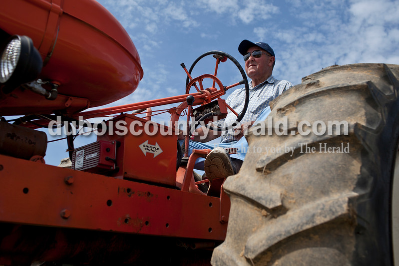 Caitlin O'Hara/The Herald<br /> Johnny Weidenbenner of Jasper waited in his 1952 AC WD tractor for his turn in the 32nd annual Celestine Tractor Pull at the Celestine Community Club on Sunday. Weidenbenner has competed in the event every year since its debut. The event benefitted the Celestine Volunteer Fire Department.