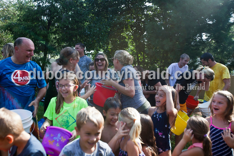 """Caitlin O'Hara/The Herald<br /> Jasper Mayor Terry Seitz, left, Kristen (Seitz) Ruhe, Chelsea Schuler, Lori (Seitz) Werner, all of jasper, laughed among friends and family after they completed the Ice Bucket Challenge at Kristen (Seitz) Ruhe's home in Jasper on Saturday. Kristen is the daughter of Ann Seitz who passed away from Amyotrophic Lateral Sclerosis in 2010. The Ice Bucket Challenge is a viral fundraising campaign benefitting The ALS Association, and you can donate at  <a href=""""http://www.alsa.org"""">http://www.alsa.org</a>."""