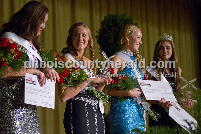From left, award-winners Katelyn Kendall of Holland, 17, Bailey Barrett of Huntingburg, 16, Taylor Miles of Holland and Lauren Meyer of Holland, 15, prepared to pose for photos after the Miss Holland Community Festival Scholarship Pageant on Sunday at Southridge High School. Kendall won Miss Congeniality and Second Runner-up, Barrett won Miss Photogenic, Miles won First Runner-up and Meyer won Miss Holland.<br /> Caitlin O'Hara/The Herald