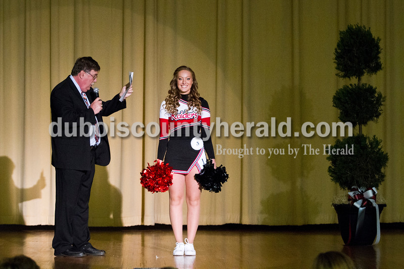 Bailey Barrett of Huntingburg, 16, said that she contributed to the Holland community through cheering on the Southridge Raiders during the Miss Holland Community Festival Scholarship Pageant on Sunday at Southridge High School. Barrett won Miss Photogenic. WITZ Radio host Walt Ferber of Holland emceed the event.<br /> Caitlin O'Hara/The Herald