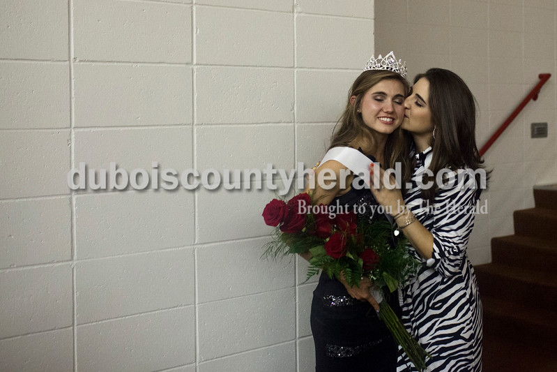 "Lauren Meyer of Holland, 15, received a congratulatory kiss from her sister Lindsey Riehle of Newburgh after being crowned at the Miss Holland Community Festival Scholarship Pageant on Sunday at Southridge High School. Meyer decided to compete in the pageant on Wednesday with encouragement from fellow contestants Kendyl McKeough and Aubrey Main, Meyer's mother Eileen said. ""It was a 'If you do it, I'll do it' kind of thing.""<br /> Caitlin O'Hara/The Herald"