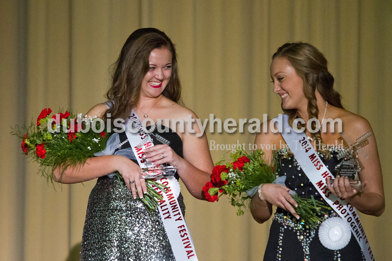 Katelyn Kendall of Holland, 17, and Bailey Barrett of Huntingburg, 16, congratulated each other after the Miss Holland Community Festival Scholarship Pageant on Sunday at Southridge High School. Kendall won Miss Congeniality and Second Runner-up and Barrett won Miss Photogenic.<br /> Caitlin O'Hara/The Herald