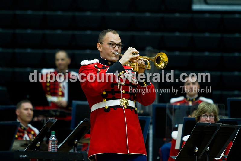 "Caitlin O'Hara/The Herald<br /> Jasper-native Brad Weil snuck the IU fight song and ""Back Home Again In Indiana"" into his trumpet solo during ""The President's Own"" United States Marine Band performance on Saturday at Jasper High School. He received a standing ovation."