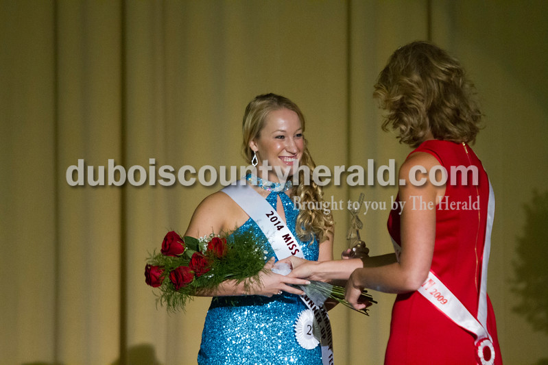Taylor Miles of Holland received her award for Second Runner-up from 2009 Miss Holland Lauren Sergesketter of Holland during the Miss Holland Community Festival Scholarship Pageant on Sunday at Southridge High School.<br /> Caitlin O'Hara/The Herald