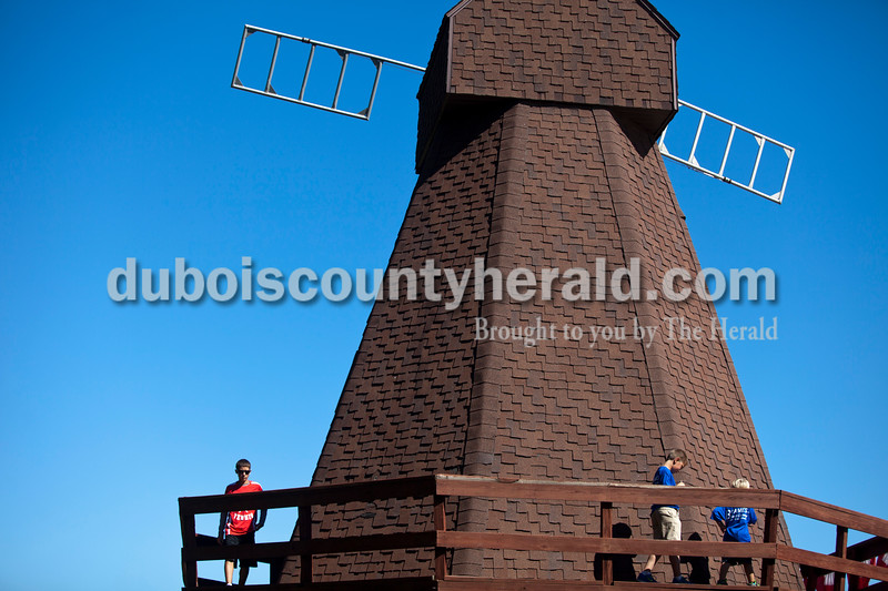 Logan Welp of Holland, 14, left, Kai Kunz of Jasper, 7, and Kunz's brother Kasen, 4, toured the Holland Windmill during the Holland Community Festival on Saturday.<br /> Caitlin O'Hara/The Herald