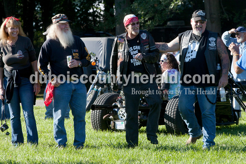 """Rhonda Kerby, left, and her husband, Carlton """"The Wizzard"""" Kerby both of of West Baden, Bob Eckert of Jasper and Henry Conway Jr. of Mitchell shared a laugh during the 30th annual ABATE of Indiana Region 10 Southern Hills Bash at the Ireland Sportsman Club on Saturday. Heather Rousseau/The Herald"""